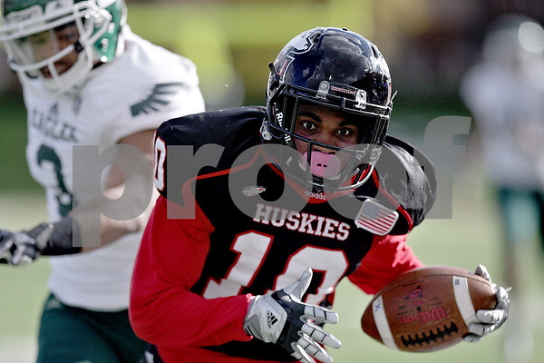 Monica Maschak - mmaschak@shawmedia.com<br /> Wide receiver Tommylee Lewis gains a first down in the first quarter against Eastern Michigan University on Saturday, October 26, 2013. The Huskies won 59-20.