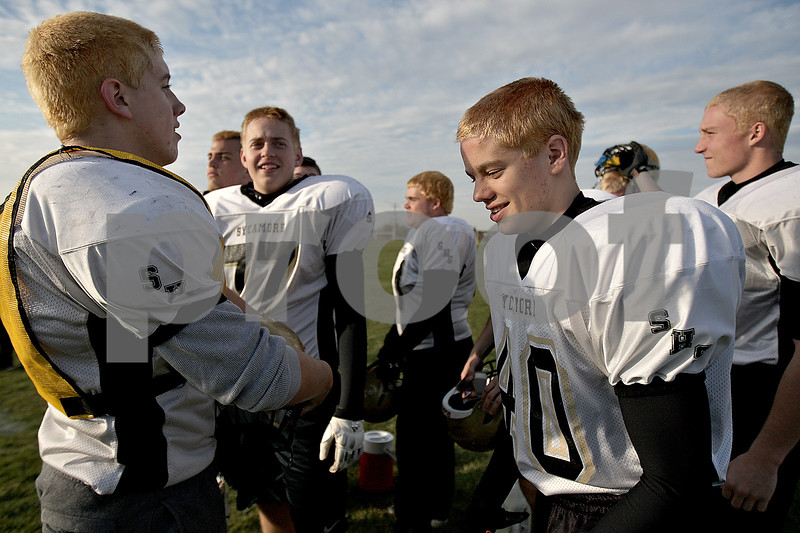 Monica Maschak - mmaschak@shawmedia.com<br /> The Spartan football team breaks from practice for water. The team dawned bleached hair as an act of camaraderie in time for playoffs.