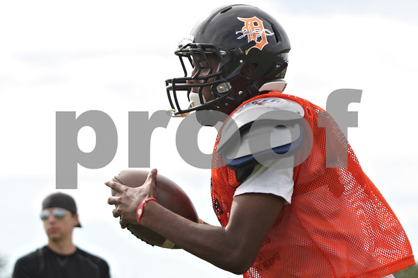 Rob Winner – rwinner@shawmedia.com<br /> <br /> Eriq Torrey participates in a running back drill during practice at DeKalb on Tuesday, Sept. 3, 2013.