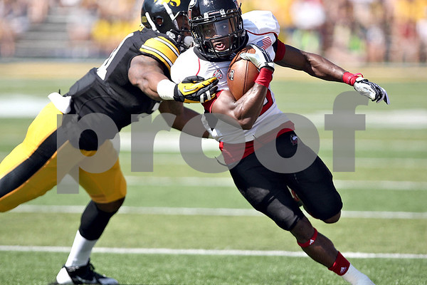 Monica Maschak - mmaschak@shawmedia.com<br /> Wide receiver Tommylee Lewis makes a run through the Hawkeyes' offense during the first quarter against Iowa at Kinnick Stadium on Saturday, August 31, 2013.