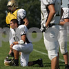 Rob Winner – rwinner@shawmedia.com<br /> <br /> Sycamore's Alec Kozak (10) rests on the sidelines during practice on Wednesday, Sept. 4, 2013.