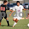 Monica Maschak - mmaschak@shawmedia.com<br /> Juan Lachuga (13) weaves the ball past Indian Creek's Stephen Muetze in the first half of a match at Genoa-Kingston High School on Thursday, September 5, 2013. The Cogs shut out the Timberwolves 6-0.