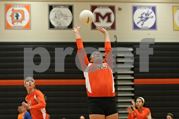 Rob Winner – rwinner@shawmedia.com<br /> <br /> DeKalb's Madison Lord (20) sets a ball during the first game against Harvest Christian Academy in DeKalb on Tuesday, Sept. 3, 2013.