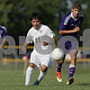 Rob Winner – rwinner@shawmedia.com<br /> <br /> Sycamore's Ivan Chavez (left) and Dixon's Brendon McCrory chase after a ball in the first half at Sycamore on Wednesday, Sept. 4, 2013.