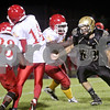 Monica Maschak - mmaschak@shawmedia.com<br /> Defensive end Austin Kosusnik makes his way toward the opposing quarterback in the second quarter against North Lawndale on Friday, September 6, 2013.