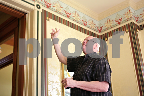 Rob Winner – rwinner@shawmedia.com<br /> <br /> On Tuesday afternoon, homeowner Jim Houis describes how the wallpaper in the front parlor room of his house was restored using stencils from the original wallpaper that was used in 1884. The home is located at 329 N. Third Street in DeKalb.