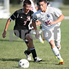 Monica Maschak - mmaschak@shawmedia.com<br /> Jake Dodd (7) and William Crozier (25) race for a loose ball in the first half of a match at Genoa-Kingston High School on Thursday, September 5, 2013. The Cogs shut out the Timberwolves 6-0.
