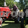 Rob Winner – rwinner@shawmedia.com<br /> <br /> Fred Barber of Sheridan parks a 1956 Farmall 300 owned by Bev Lehrkamp (not pictured) of Sandwich as preparations for the 126th annual Sandwich Fair get underway at the fairgrounds on Monday morning.<br /> <br /> Monday, Sept. 2, 2013