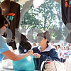 "Rob Winner – rwinner@shawmedia.com<br /> <br /> Linda Munson (left) helps Carla Baxter of Sandwich with her Sandwich Fair souvenir purchases at the Gazebo Information Center just after the opening of the 126th fair in Sandwich on Wednesday morning. Baxter, who was third in line for souvenirs, said, ""It's nice to be in line with the same people every year having good conversation and watching the fair wake up.""<br /> <br /> Wednesday, Sept. 4, 2013"