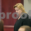 Rob Winner – rwinner@shawmedia.com<br /> <br /> Patricia Schmidt of Sycamore is seen leaving Judge Robbin Stucker's courtroom at the DeKalb County Courthouse on Wednesday, Sept. 4, 2013. Schmidt formally waived her right to a jury trial and is requesting a bench trial. Schmidt is charged in connection with the Feb. 21, 2011, crash that killed Timothy Getzelman and Alexis Weber.