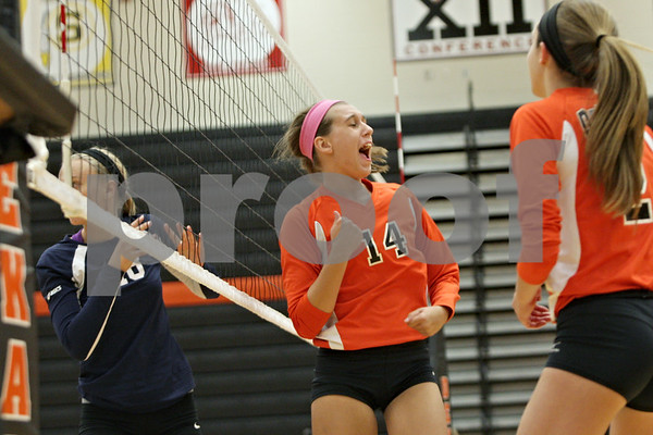Rob Winner – rwinner@shawmedia.com<br /> <br /> DeKalb's Courtney Wagner reacts after a kill during the first game against Harvest Christian Academy in DeKalb on Tuesday, Sept. 3, 2013.
