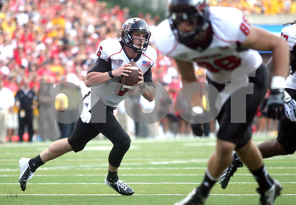 Monica Maschak - mmaschak@shawmedia.com<br /> Quarterback Jordan Lynch moves on the line to find a passing opportunity during the third quarter against Iowa at Kinnick Stadium on Saturday, August 31, 2013. The Huskies won the game 30-27.