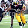 Monica Maschak - mmaschak@shawmedia.com<br /> Defensive back Dechane Durante takes down running back Mark Weisman, of the hawkeyes, during the fourth quarter against Iowa at Kinnick Stadium on Saturday, August 31, 2013. The Huskies won the game 30-27.