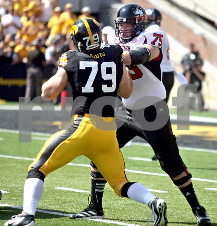 Monica Maschak - mmaschak@shawmedia.com<br /> Offensive Lineman Tyler Loos blocks a hawkeye on the line during the first quarter against Iowa at Kinnick Stadium on Saturday, August 31, 2013. The Huskies won the game 30-27.