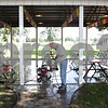 Rob Winner – rwinner@shawmedia.com<br /> <br /> Dick Brauer power washes the ground at a pavilion near the Home Arts Building on Monday, Sept. 2, 2013 at the Sandwich Fairgrounds.