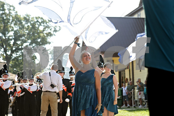 Rob Winner – rwinner@shawmedia.com<br /> <br /> Sarah Dennis of Sandwich High School twirls a flag before the flag raising ceremony near the Round Office at the Sandwich Fair on Wednesday morning.<br /> <br /> Wednesday, Sept. 4, 2013