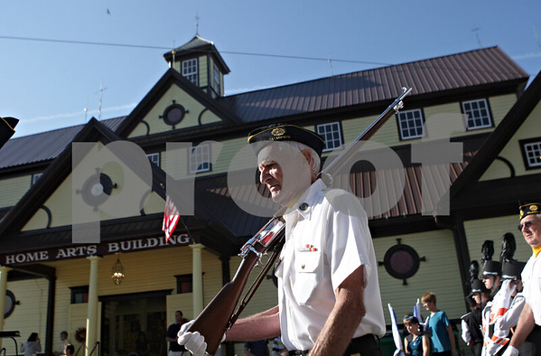 Rob Winner – rwinner@shawmedia.com<br /> <br /> Howard Andersen of Plano American Legion Post 395 passes by the Home Arts Building after the opening ceremony at the Sandwich Fair on Wednesday morning.<br /> <br /> Wednesday, Sept. 4, 2013