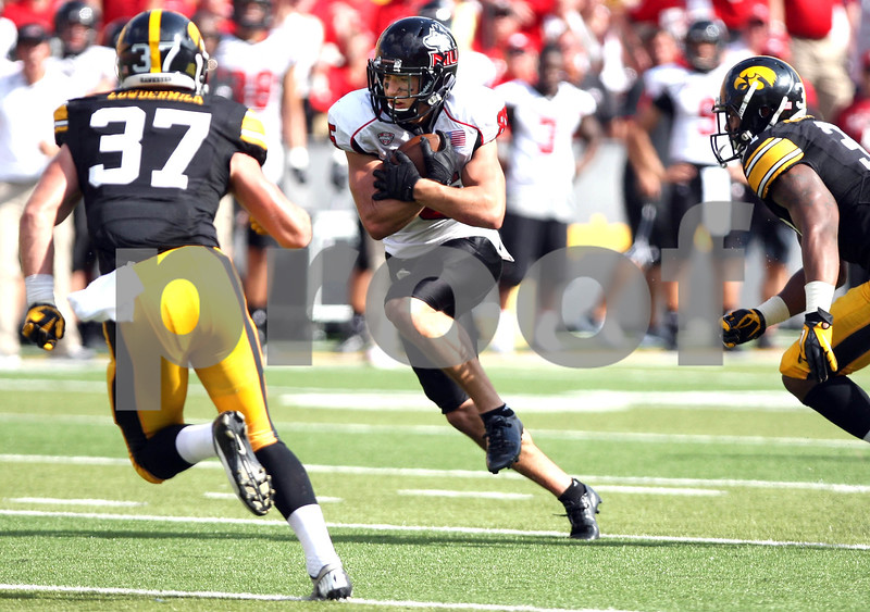 Monica Maschak - mmaschak@shawmedia.com<br /> Wide Receiver Angelo Sebastiano protects the ball as he heads towards defense during the second quarter against Iowa at Kinnick Stadium on Saturday, August 31, 2013. The Huskies won the game 30-27.
