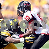 Monica Maschak - mmaschak@shawmedia.com<br /> Wide Receiver Tommylee Lewis attempts to avoid a tackle during the first quarter against Iowa at Kinnick Stadium on Saturday, August 31, 2013. The Huskies won the game 30-27.