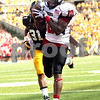 Monica Maschak - mmaschak@shawmedia.com<br /> Wide Receiver Tommylee Lewis catches the ball for a touchdown during the second quarter against Iowa at Kinnick Stadium on Saturday, August 31, 2013. The Huskies won the game 30-27.