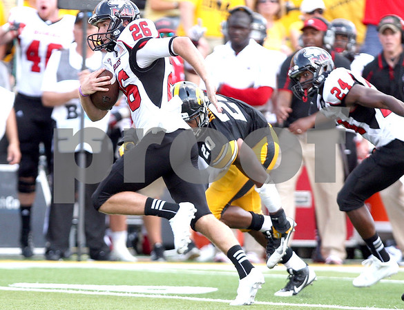 Monica Maschak - mmaschak@shawmedia.com<br /> Punter Tyler Wedel runs the ball on a fourth down during the third quarter against Iowa at Kinnick Stadium on Saturday, August 31, 2013. The Huskies won the game 30-27.