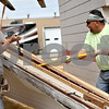 Monica Maschak - mmaschak@shawmedia.com<br /> Vic Nowak (left) and Andy Perez, from Irving Construction, tear apart a piece of roof from the former city dog pound at DeKalb Fire Station 2 on Thursday, September 5, 2013. The building will renovated and expanded into a fitness room and more sleeping quarters.