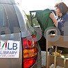 Monica Maschak - mmaschak@shawmedia.com<br /> DeKalb Public Library Outreach Coordinator Beatrice O'Connell loads her car with books. Public libraries in the county such as DeKalb offer a home delivery service for people who are homebound, whether they are ill or disabled. DeKalb's program is offered for free and for all residents, no matter the age.