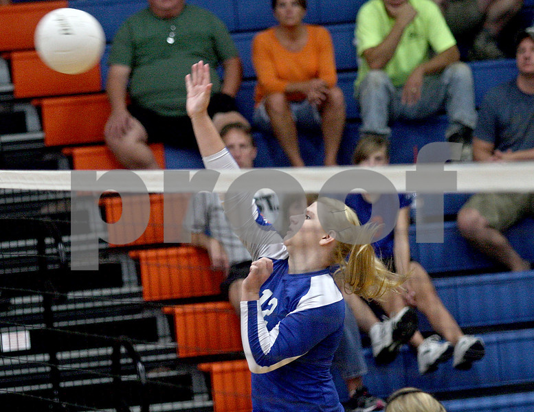 Monica Maschak - mmaschak@shawmedia.com<br /> Cassidy Abraham spikes for a point during the second set of a match against North Boone on Thursday, September 12, 2013. The Cogs won two consecutive sets, defeating the Vikings in the match.