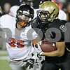 Rob Winner – rwinner@shawmedia.com<br /> <br /> Sycamore running back Dion Hooker carries the ball in the first quarter on Friday night at Huskie Stadium in DeKalb.