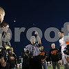 Rob Winner – rwinner@shawmedia.com<br /> <br /> The head official flips a coin during the coin toss before the start of Friday night's game between Sycamore and DeKalb.