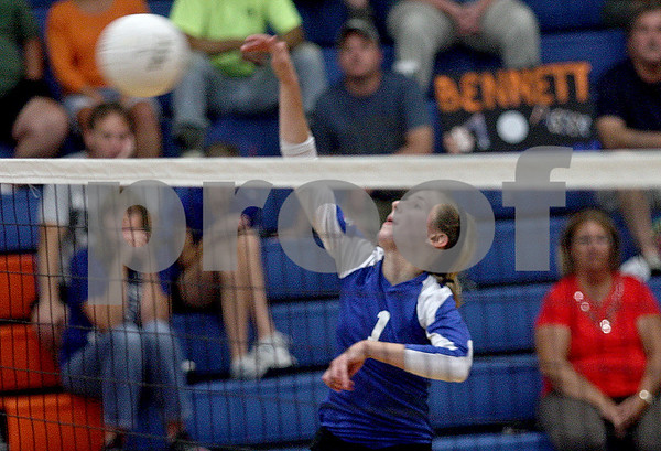 Monica Maschak - mmaschak@shawmedia.com<br /> Bridget Halat spikes the ball during the second set of a match against North Boone on Thursday, September 12, 2013. The Cogs won two consecutive sets, defeating the Vikings in the match.