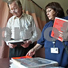 Monica Maschak - mmaschak@shawmedia.com<br /> Resident Dan Riordan and DeKalb Public Library Outreach Coordinator Beatrice O'Connell look over the books she dropped off for Riordan at the Bethany Health Care and Rehabilitation Center. Public libraries in the county such as DeKalb offer a home delivery service for people who are homebound, whether they are ill or disabled. DeKalb's program is offered for free and for all residents, no matter the age.