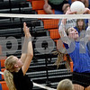 Monica Maschak - mmaschak@shawmedia.com<br /> Bridget Halat sets the ball during the second set of a match against North Boone on Thursday, September 12, 2013. The Cogs won two consecutive sets, defeating the Vikings in the match.