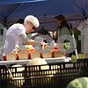 Rob Winner – rwinner@shawmedia.com<br /> <br /> Sycamore resident Dorothy Zulauf searches for tomatoes at the Theis Farm II stand at the DeKalb Farmer's Market at the Frank Buer Plaza on Thursday afternoon. Zulauf visits the market every week.
