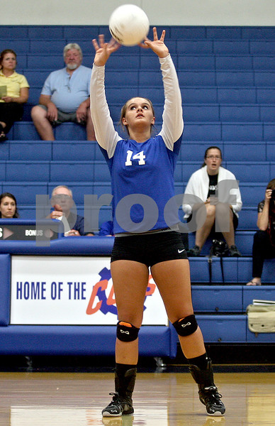Monica Maschak - mmaschak@shawmedia.com<br /> Breea Rogalla sets to a teammate during the first set of a match against North Boone on Thursday, September 12, 2013. The Cogs won two consecutive sets, defeating the Vikings in the match.