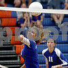 Monica Maschak - mmaschak@shawmedia.com<br /> Ireland Milinac attempts to bump the ball over the net during the second set of a match against North Boone on Thursday, September 12, 2013. The Cogs won two consecutive sets, defeating the Vikings in the match.