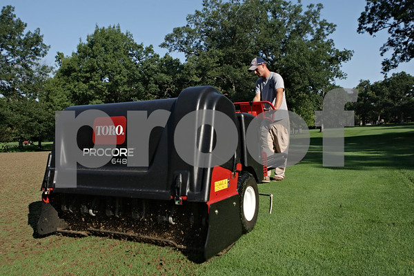 Rob Winner – rwinner@shawmedia.com<br /> <br /> Mike Gunderson uses a machine to aerate the green near the 14th hole at Kishwaukee Country Club in DeKalb on Tuesday morning.<br /> <br /> Tuesday, Sept. 10, 2013