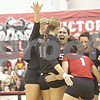 Monica Maschak - mmaschak@shawmedia.com<br /> The ladies celebrate getting the first point in the first set of a match against the University of Southern California at the Convocation Center on Saturday, September 7, 2013. The Huskies lost, winning only 1 of 4 sets.