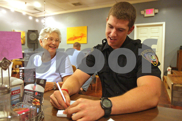 Monica Maschak - mmaschak@shawmedia.com<br /> Patrolman Josh Boldt, with the DeKalb Police Department, writes down customer Phyillis Cain's order at Feed 'em Soup on Wednesday, September 11, 2013.