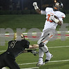 Monica Maschak - mmaschak@shawmedia.com<br /> DeKalb halfback Dre Brown gets snagged by Syamore safety Ben Niemann in the first quarter at Huskie Stadium on Friday, September 13, 2013.