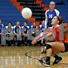 Monica Maschak - mmaschak@shawmedia.com<br /> Olivia Cotton bumps a returned ball during the first set of a match against North Boone on Thursday, September 12, 2013. The Cogs won two consecutive sets, defeating the Vikings in the match.
