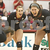 Monica Maschak - mmaschak@shawmedia.com<br /> Tori Halbur and Lauren Zielinski scream with satisfaction on gaining a point in the fourth set of a match against the University of Southern California at the Convocation Center on Saturday, September 7, 2013. The Huskies lost, winning only 1 of 4 sets.