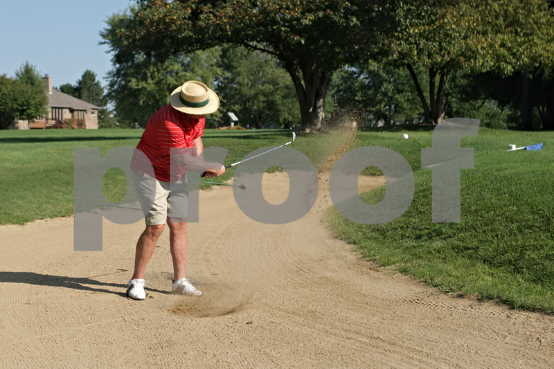 Rob Winner – rwinner@shawmedia.com<br /> <br /> Golfer John Jacobson of DeKalb hits out of a sand trap on the 10th hole at the Kishwaukee Country Club in DeKalb on Tuesday, Sept. 10, 2013.