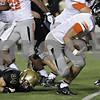 Rob Winner – rwinner@shawmedia.com<br /> <br /> DeKalb quarterback Jack Sauter carries the ball for a touchdown in the first quarter on Friday night at Huskie Stadium in DeKalb.