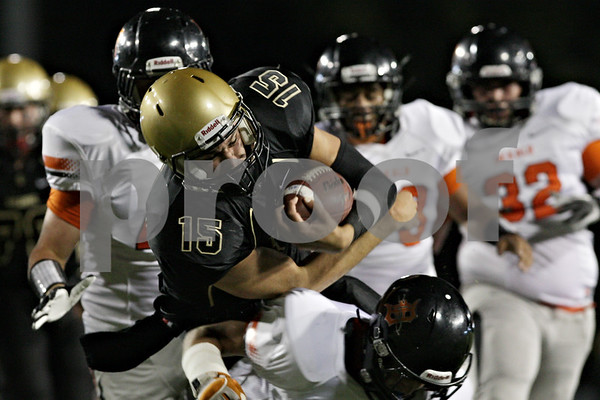 Rob Winner – rwinner@shawmedia.com<br /> <br /> Sycamore quarterback Devin Mottet carries the ball during the Spartans first possession in the first quarter on Friday night at Huskie Stadium in DeKalb.