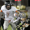 Rob Winner – rwinner@shawmedia.com<br /> <br /> DeKalb quarterback Jack Sauter carries the ball in the first quarter on Friday night at Huskie Stadium in DeKalb.