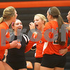Monica Maschak - mmaschak@shawmedia.com<br /> DeKalb celebrates gaining a point in the second of two sets between DeKalb and Sycamore on Tuesday, September 17, 2013. DeKalb won both sets.