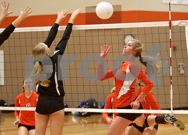 Monica Maschak - mmaschak@shawmedia.com<br /> Courtney Bemis gives the ball a tap in the first of two sets between DeKalb and Sycamore on Tuesday, September 17, 2013. DeKalb won both sets.