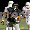 Monica Maschak - mmaschak@shawmedia.com<br /> Halfback Eriq Torrey carries the ball in the first quarter of Ottawa at DeKalb on Friday, September 20, 2013.