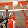 Monica Maschak - mmaschak@shawmedia.com<br /> Heather Bemis and Abby Hickey jump for a block in the first of two sets between DeKalb and Sycamore on Tuesday, September 17, 2013. DeKalb won both sets.